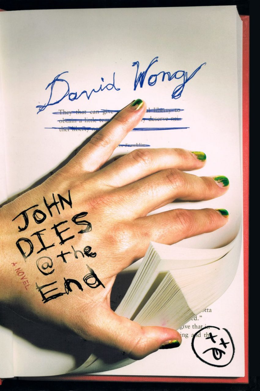 Cover of the text John Dies at the End; cover shows a disembodied hand with chipped green nail polish flipping the pages of a book.